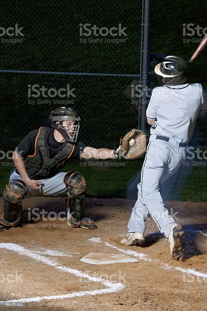 STRIKE! Baseball Player Swinging The Bat royalty-free stock photo
