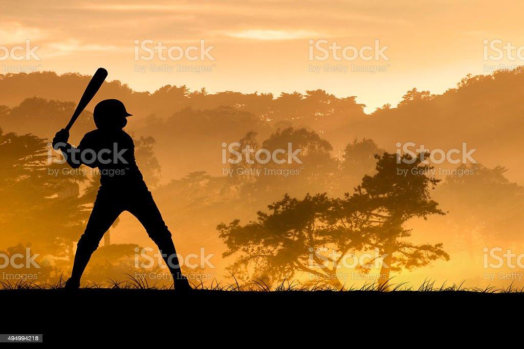 Baseball Player Swings Bat stock photo