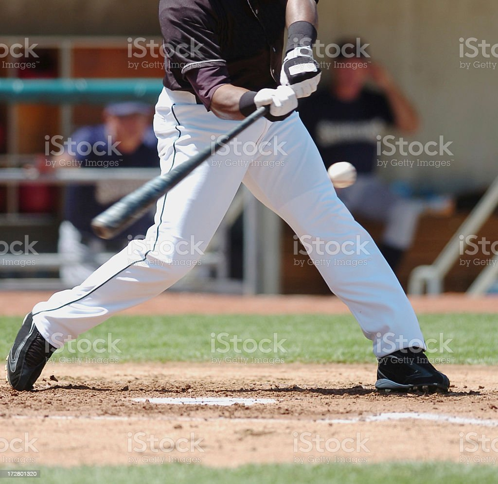 Baseball Player Swings for the fences. stock photo