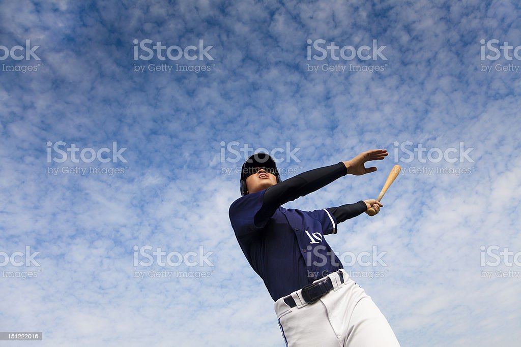 A baseball player taking a big swing stock photo