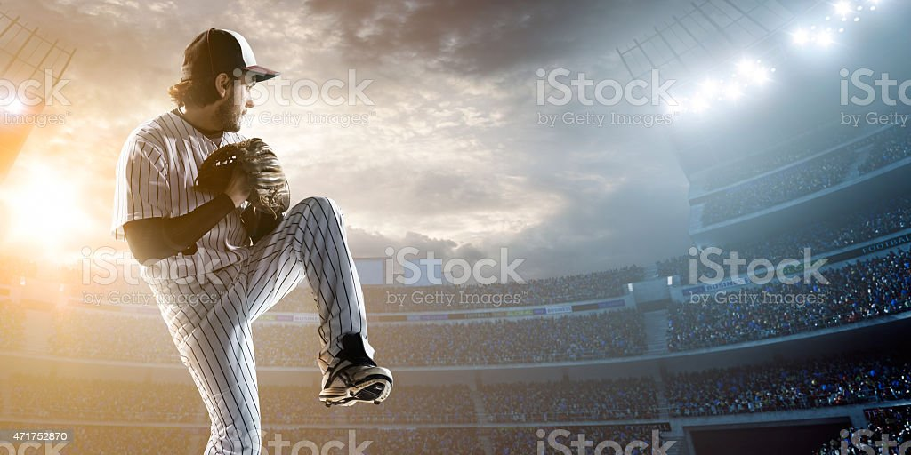 Baseball player throwing a ball in stadium stock photo