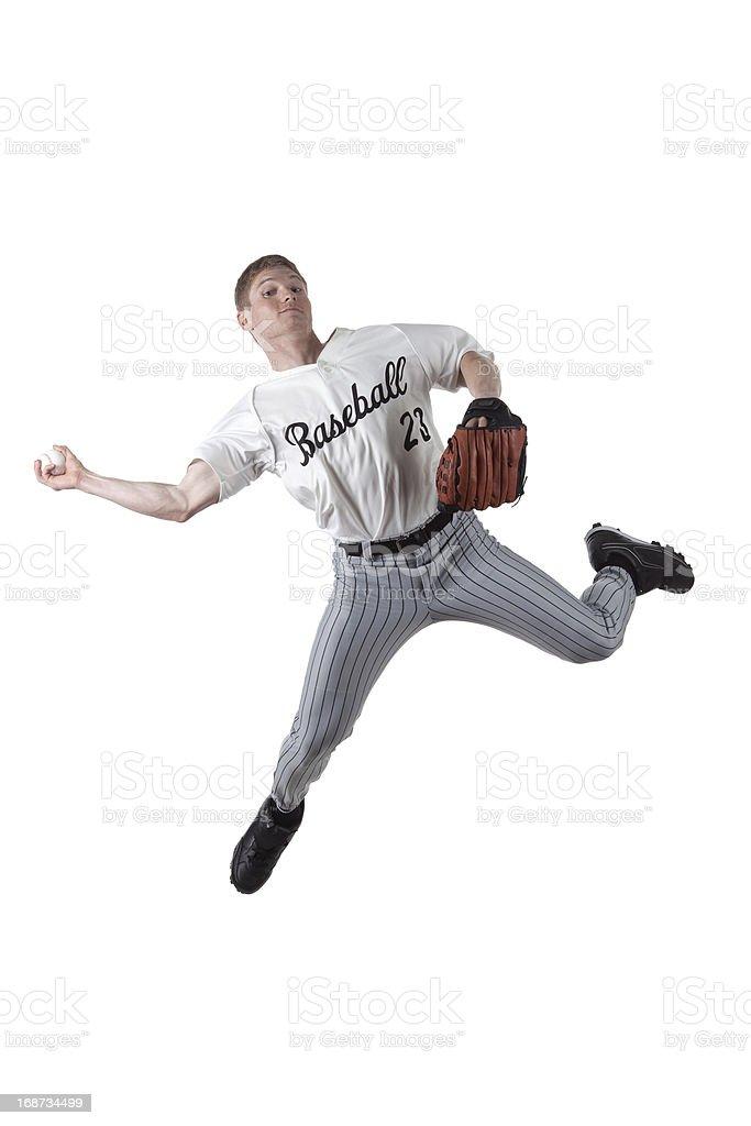 Baseball player throwing a ball royalty-free stock photo
