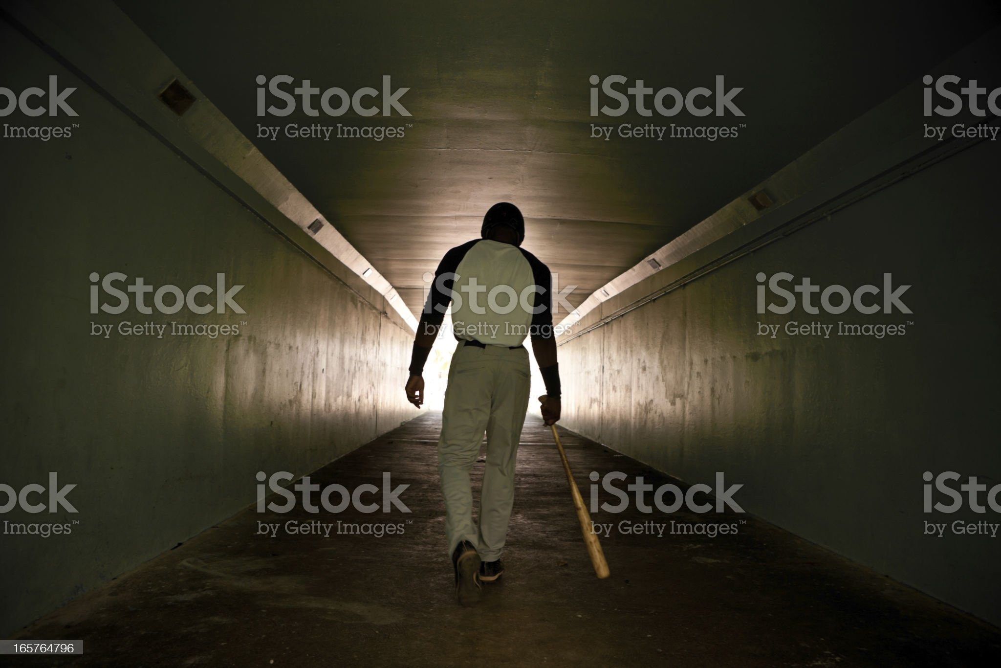 Baseball player walking with bat royalty-free stock photo