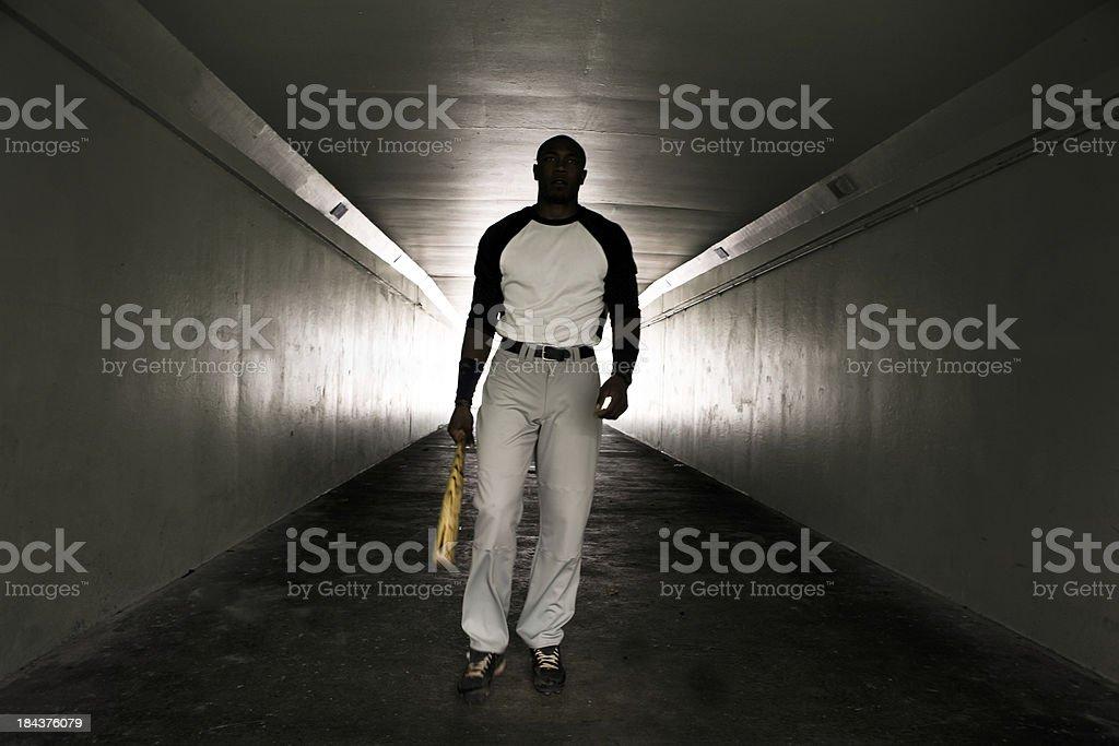 Baseball player walking with bat royalty-free stock photo