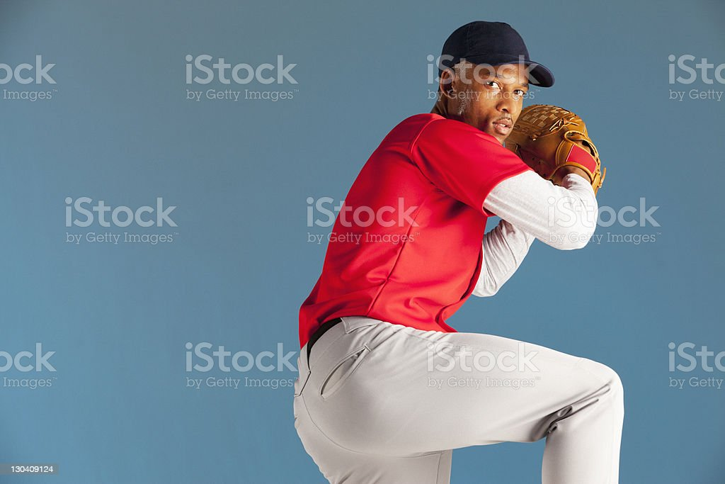 Baseball player winding up a pitch stock photo