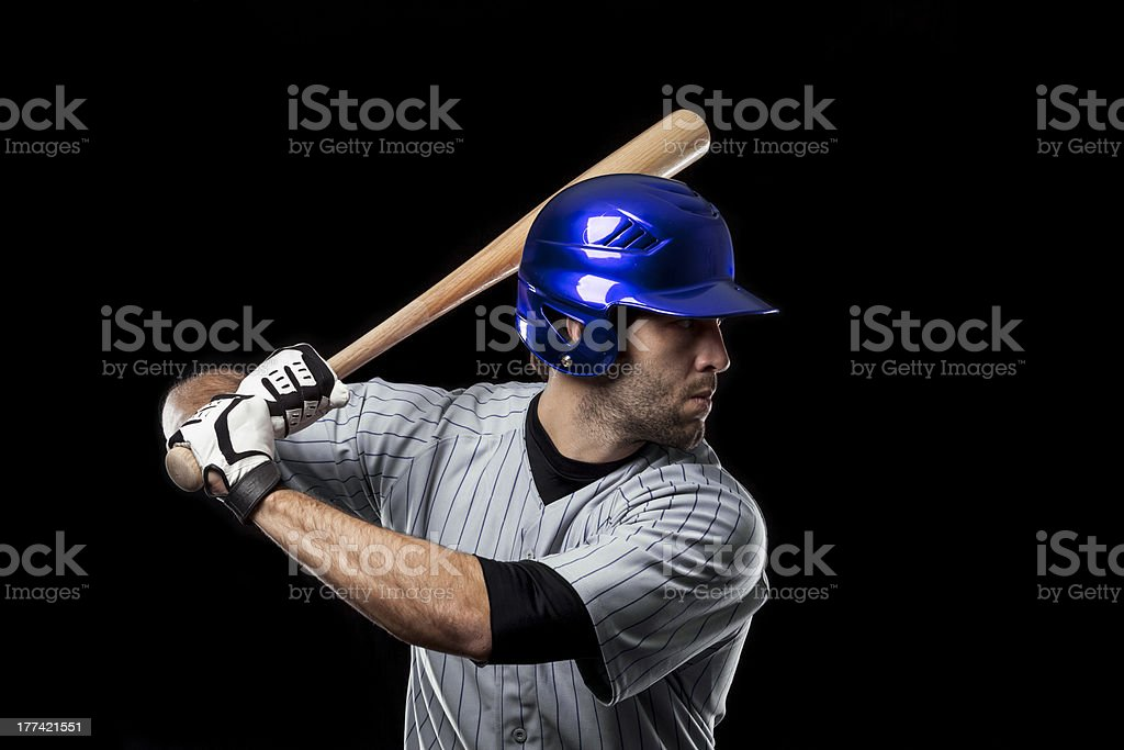 A baseball player with a blue helmet ready to hit a ball stock photo