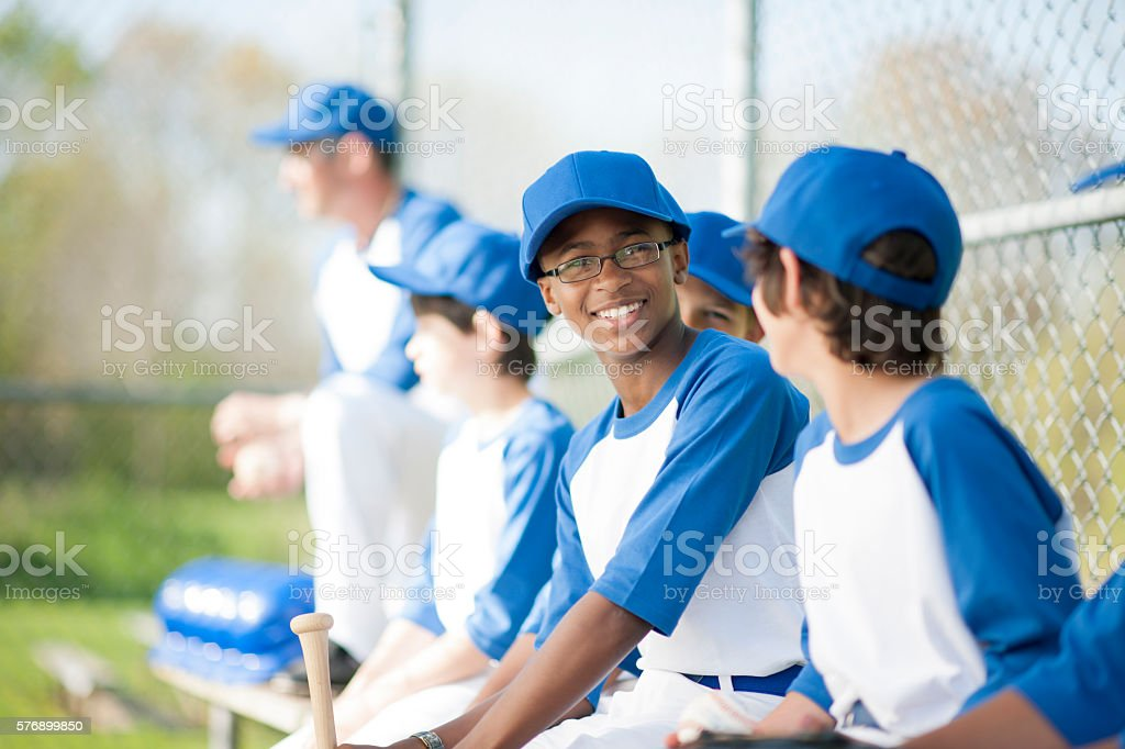 Baseball Players in the Dugout stock photo