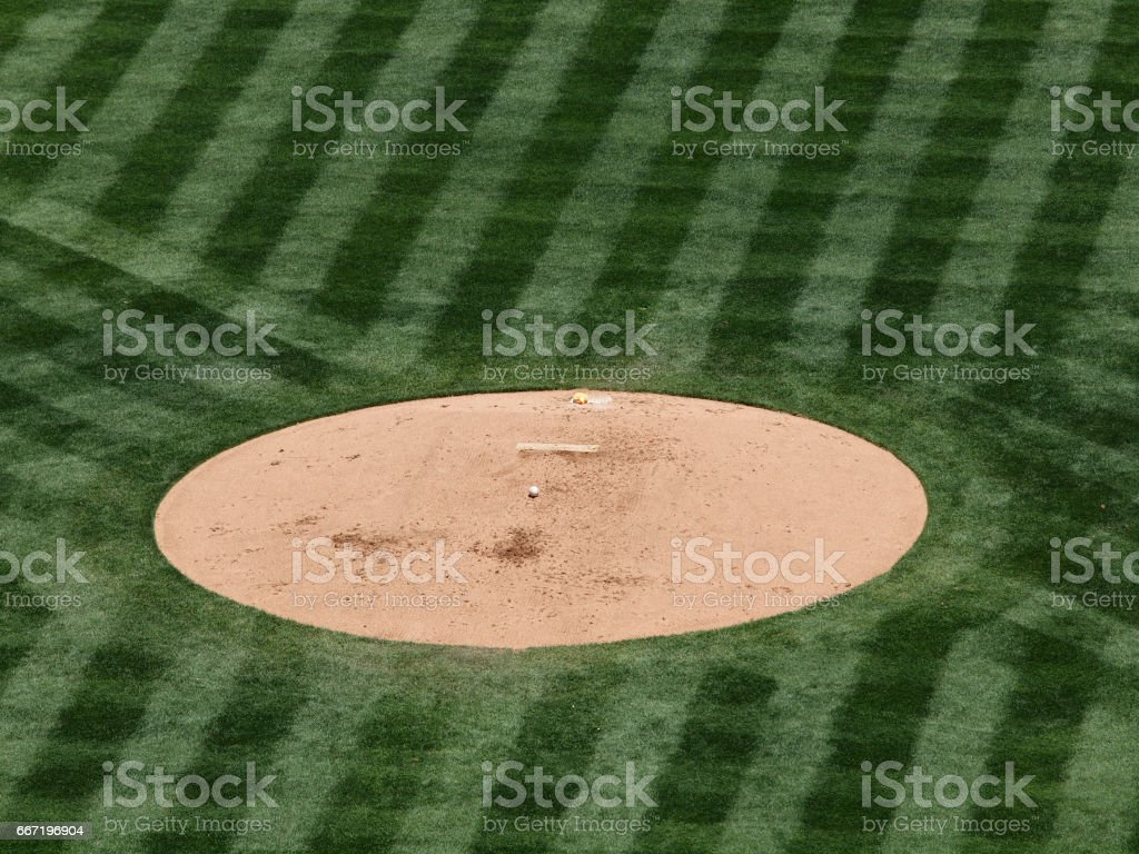 baseball rest on a mound stock photo