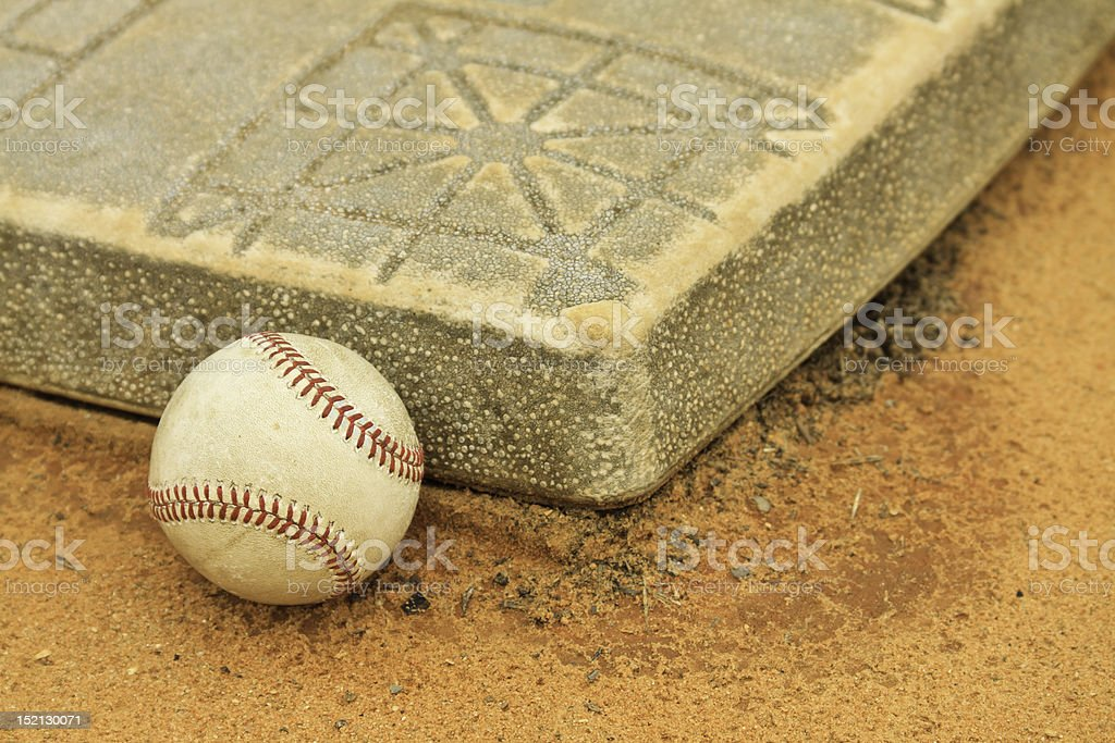 Baseball Resting Against First Base stock photo