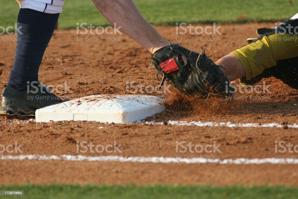 Baseball runner sliding into third base stock photo