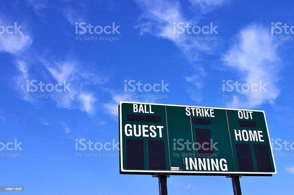 Baseball scoreboard and blue sky stock photo