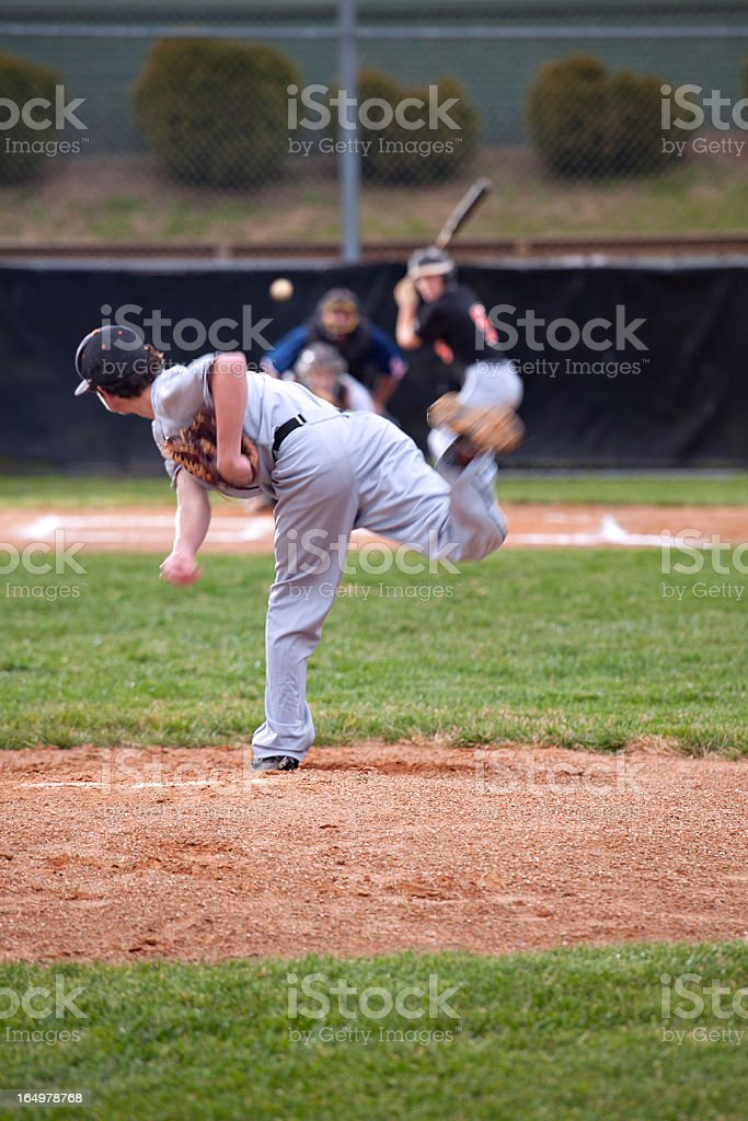 Baseball Series: Pitcher in motion, ball released mid-air stock photo