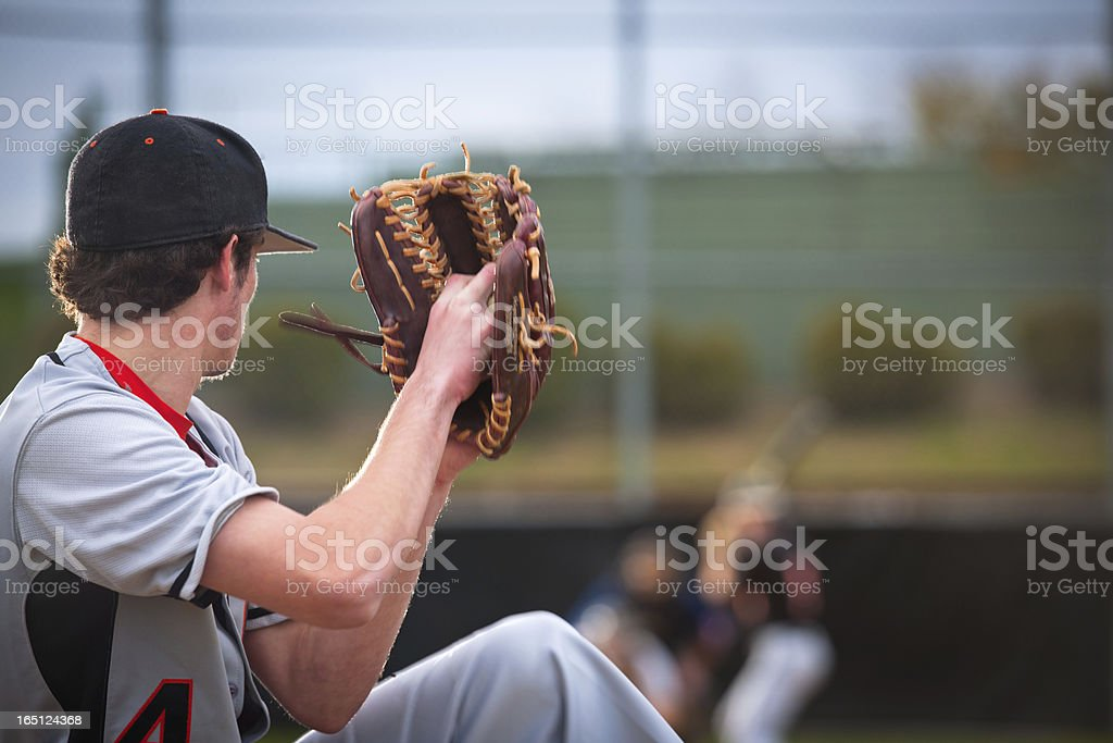 Baseball Series: Pitcher in motion, batter, catcher and umpire defocused stock photo