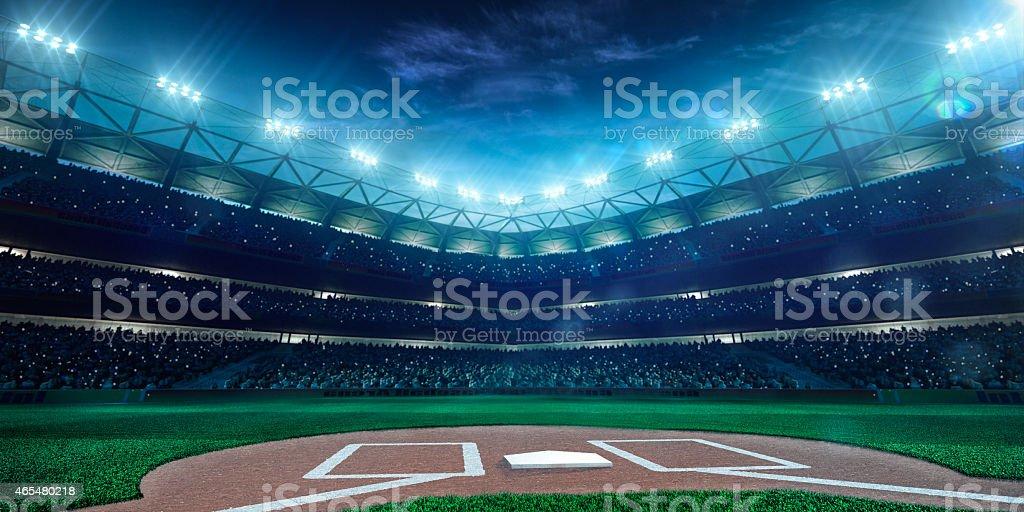 Baseball stadium lit up at night stock photo