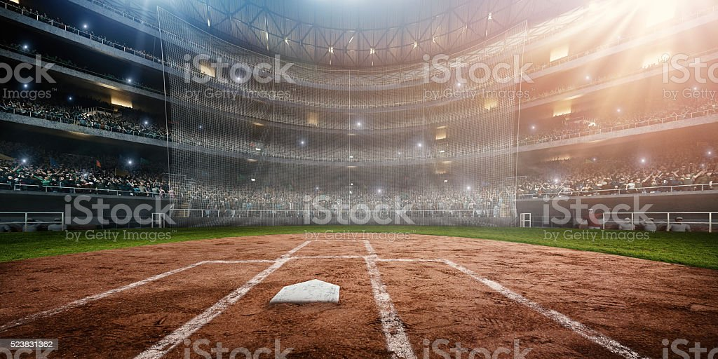 A wide angle of a outdoor baseball stadium full of spectators under a...