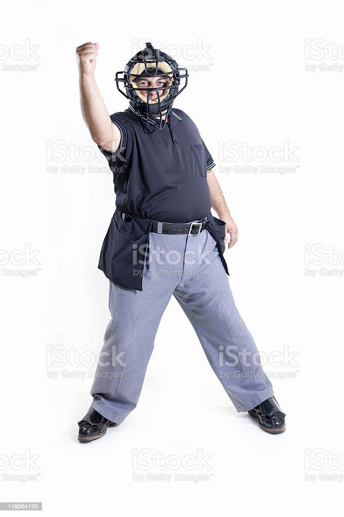 Baseball umpire wearing protective uniform with raised arm royalty-free stock photo
