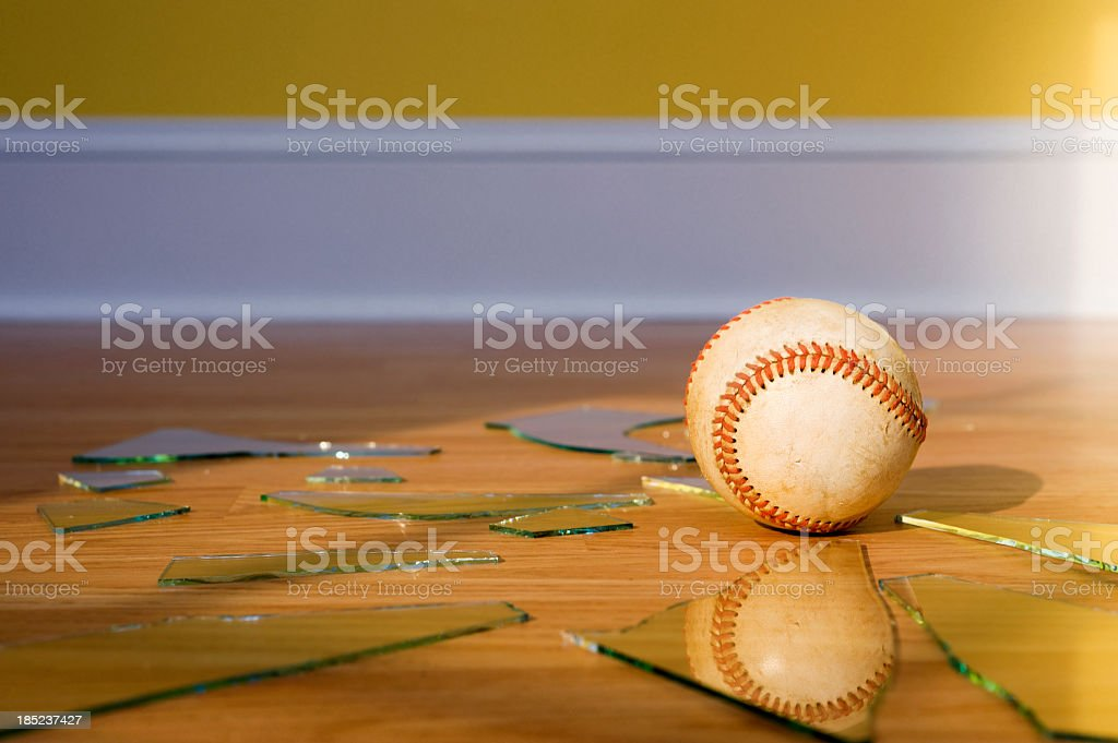 Baseball with Broken Window glass on wood floor stock photo