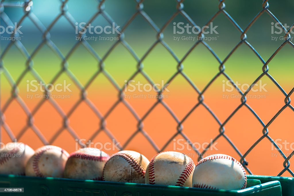 Baseballs in dugout stock photo
