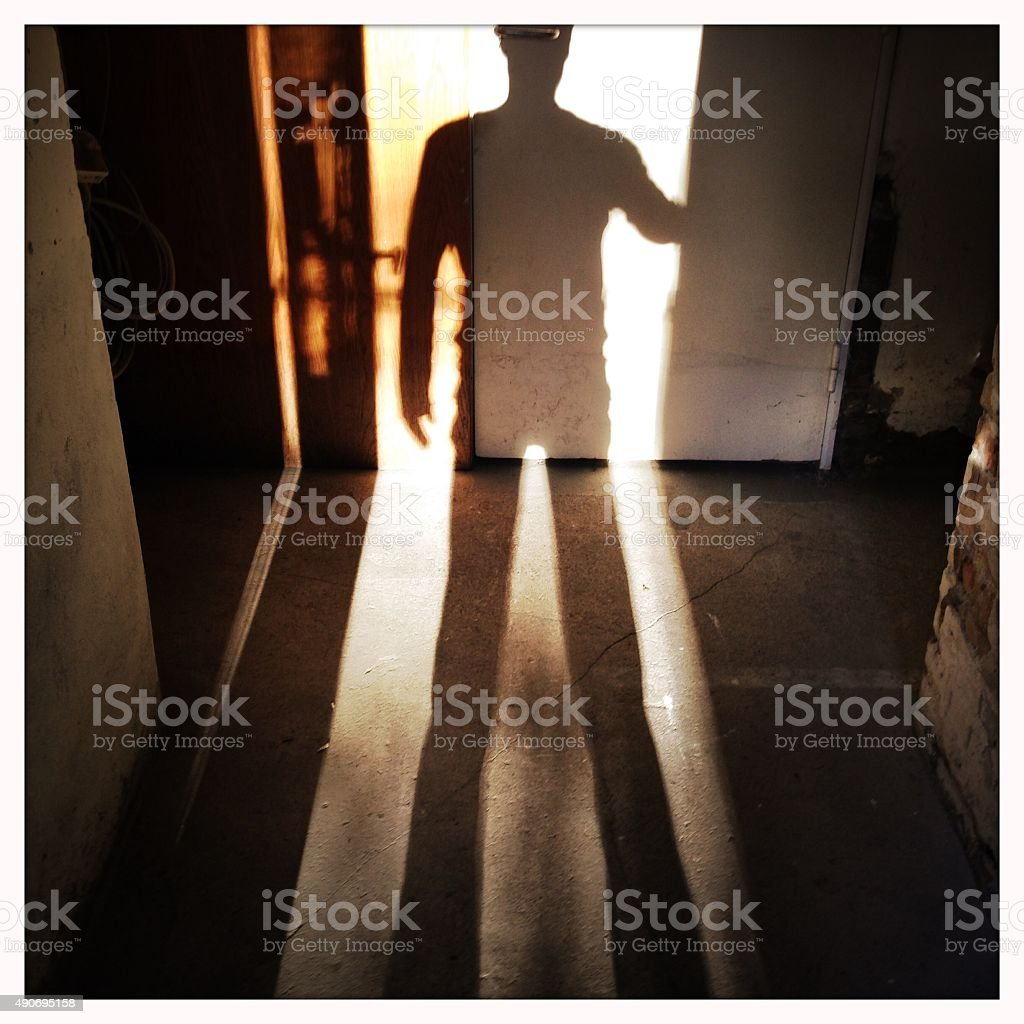 Basement Shadow Man stock photo