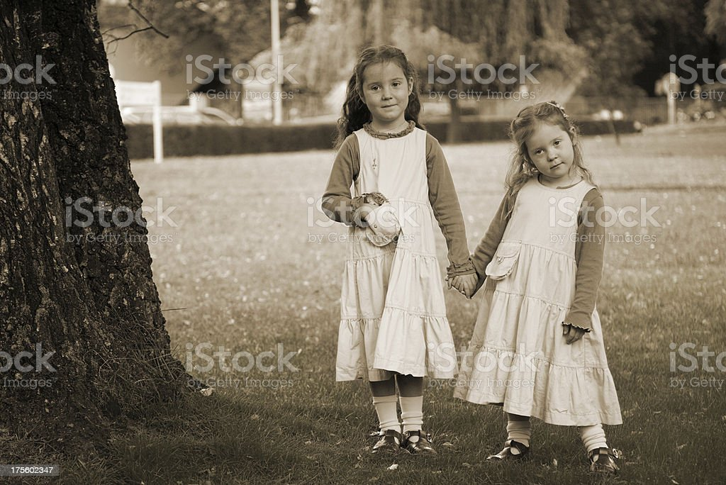 Bashful girls in the garden, ready for first school day royalty-free stock photo