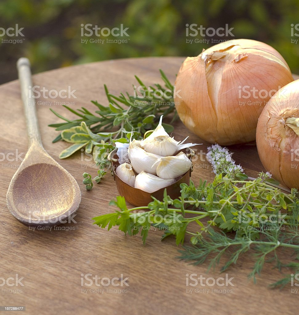 Basic Cooking Ingredients; Fresh Garlic, Onions, Rosemary, Sage & Thyme Herbs stock photo