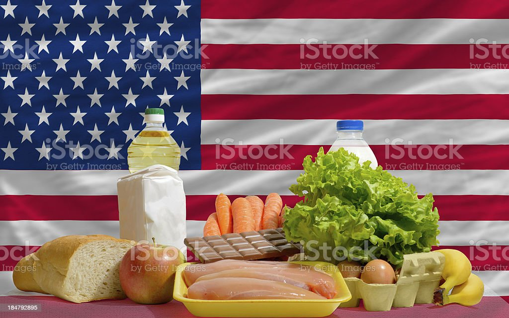basic food groceries in front of america national flag stock photo