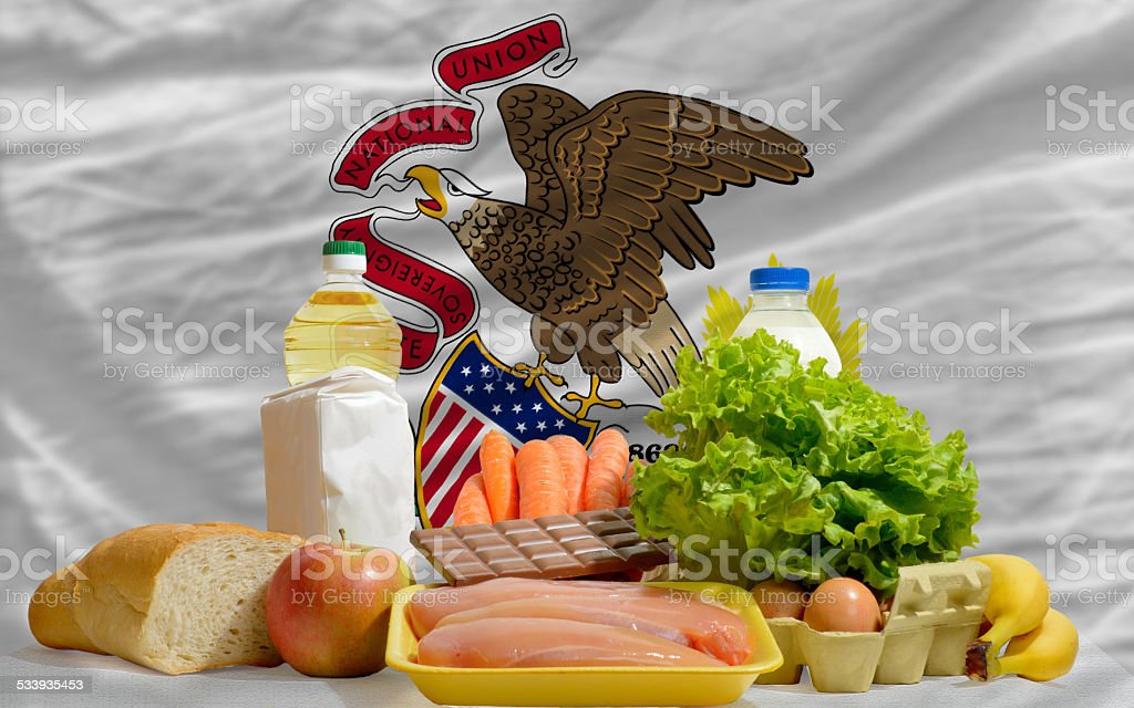 basic food groceries in front of illinois us state flag stock photo