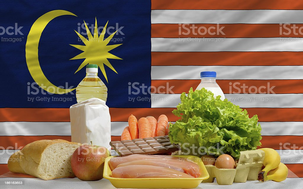 basic food groceries in front of malaysia national flag royalty-free stock photo