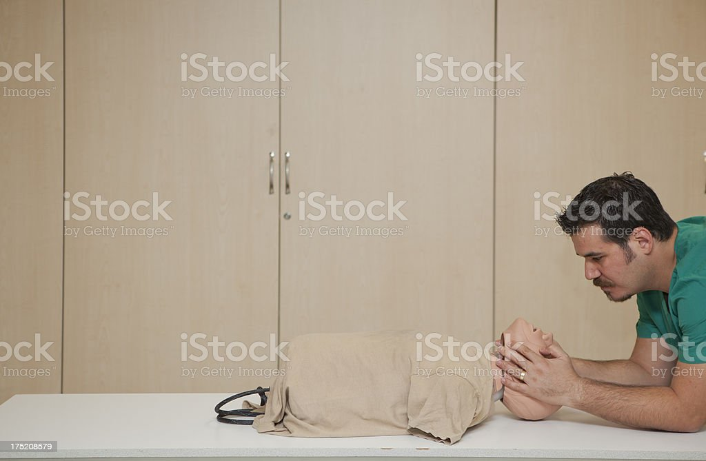 Basic life support training with a CPR Dummy-servikal immobilization royalty-free stock photo