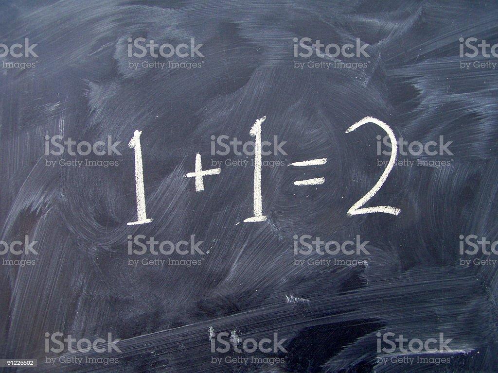 Basic maths on blackboard stock photo