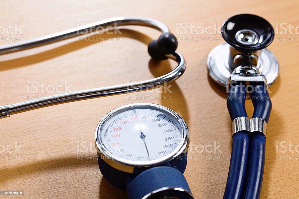 Basic medical examination equipment: stethoscope and blood pressure gauge stock photo
