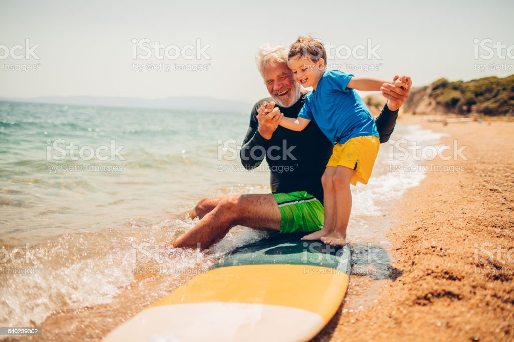 Basics of surfing with my grandpa stock photo