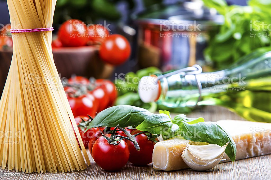 Basil leaves garlic pene,spghetti and cherry tomatoes stock photo