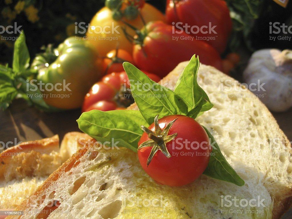 Basil & Olive Oil on Bread, Picnic with Organic Heirloom Tomatoes royalty-free stock photo