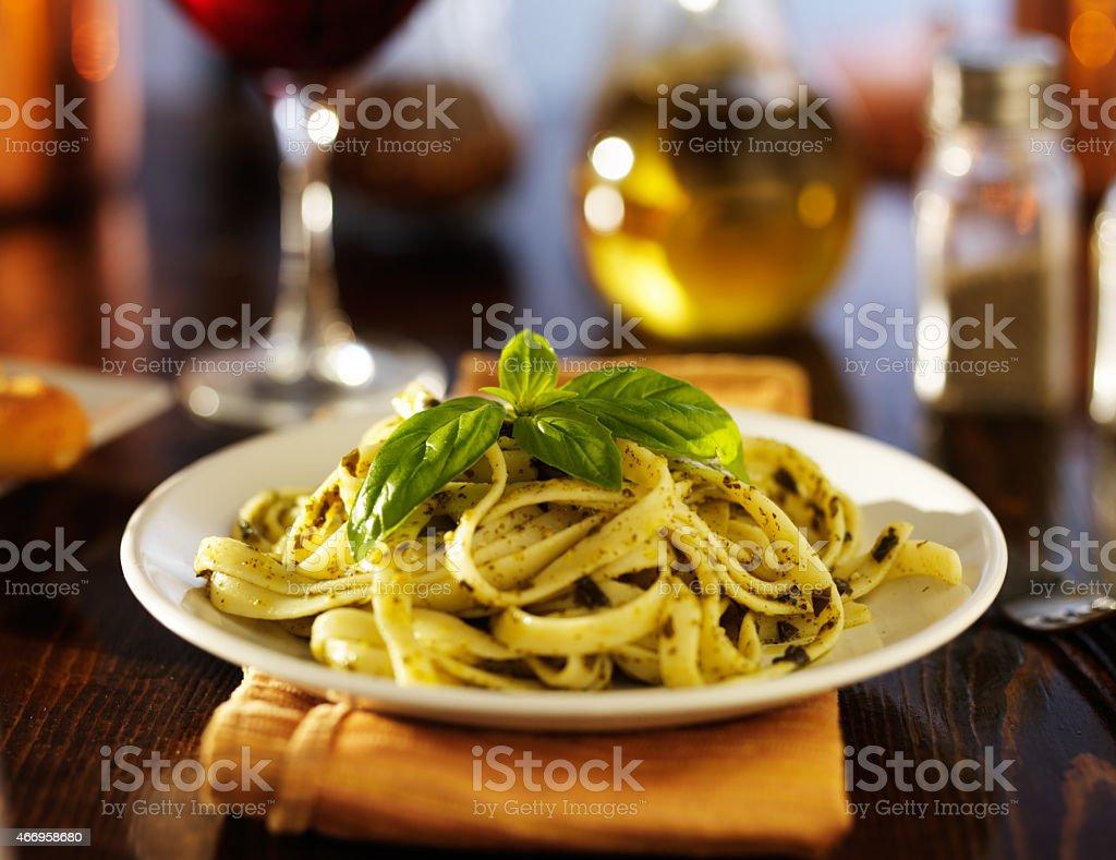 basil pesto sauce on fettuccine pasta stock photo