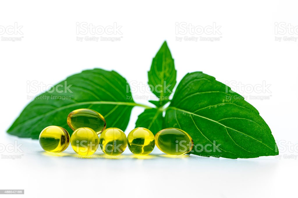 Basil softgel capsules supplement stock photo