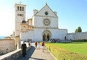 Basilica of Saint Francis of Assisi, Priest, Tourists, Assisi, Italy.