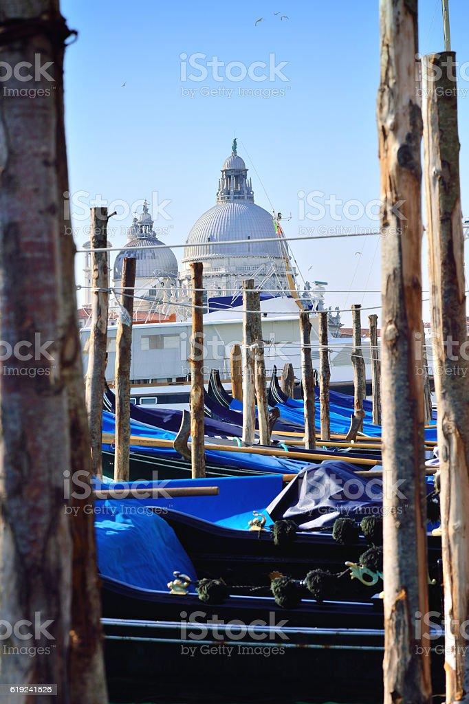 Basilica Santa Maria della Salute and Gondolas pier, Venice, Italy stock photo
