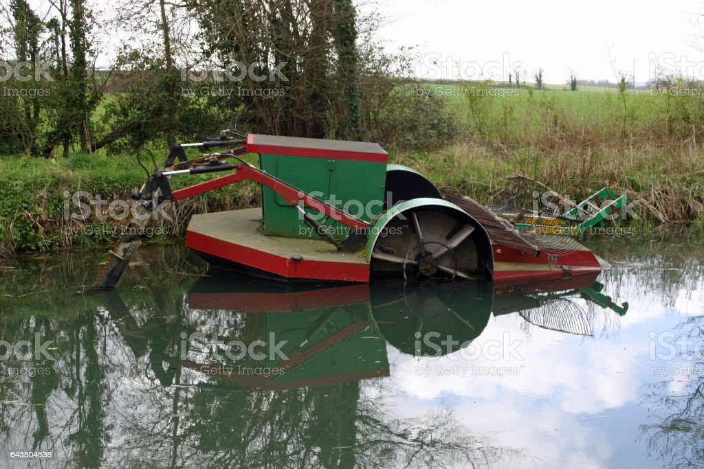 Basingstoke canal weedcutting boat stock photo