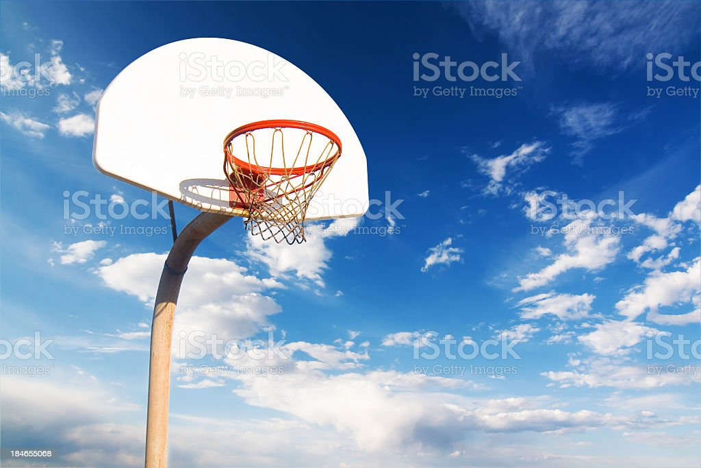 Baskeball Hoop on Cloudy Day stock photo