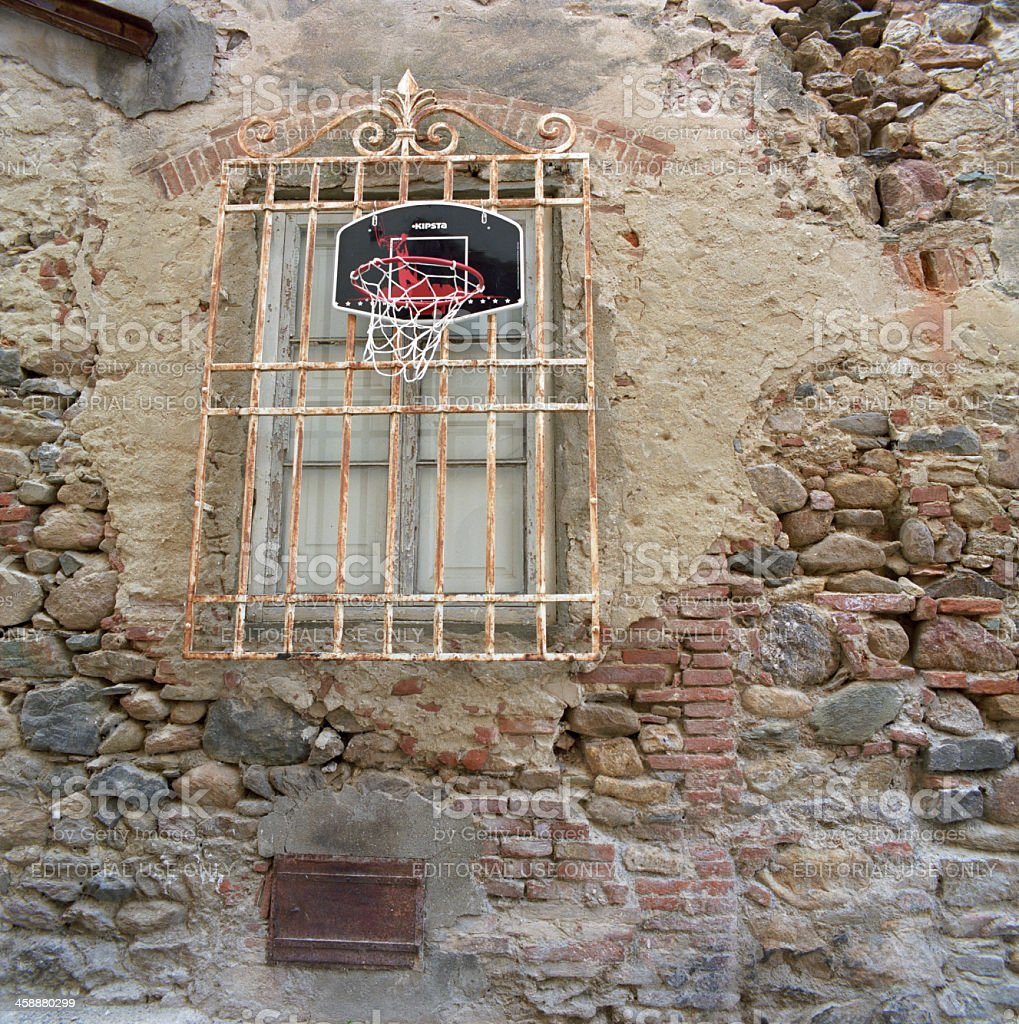 Basket for basketball in old Italian village stock photo