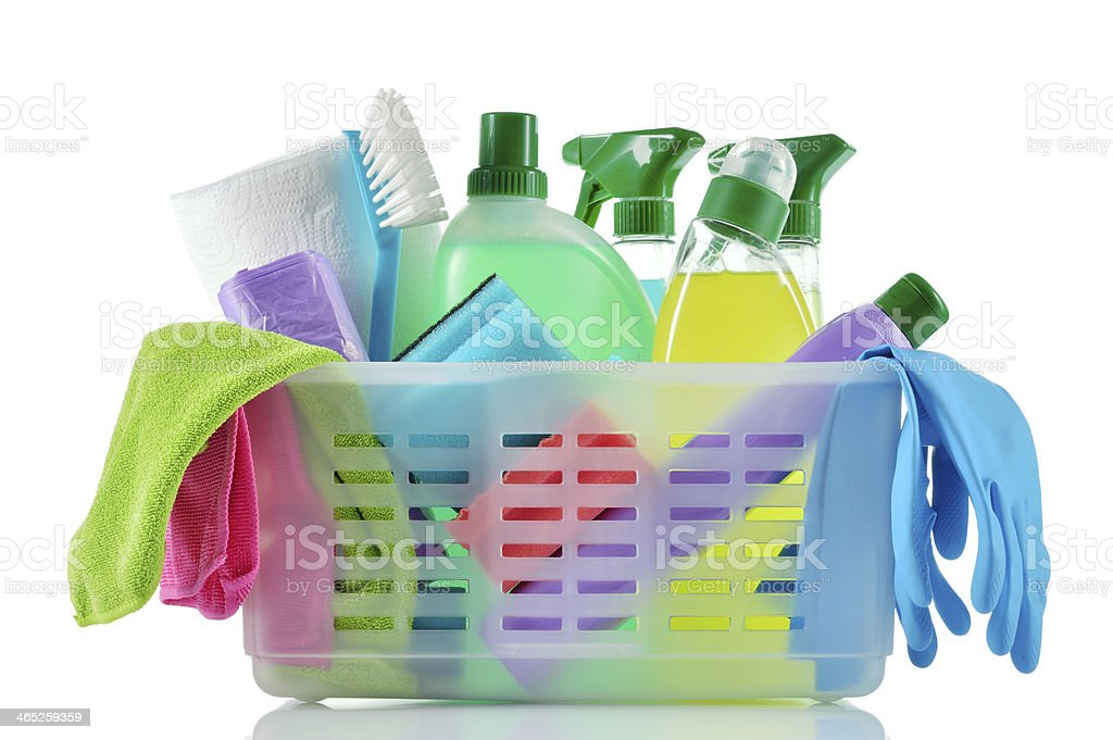 A basket full of cleaning supplies and cloths stock photo