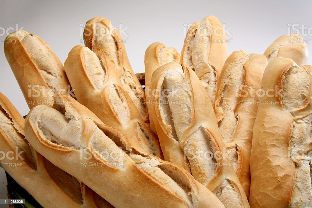 Basket full of fresh baked French bread stock photo
