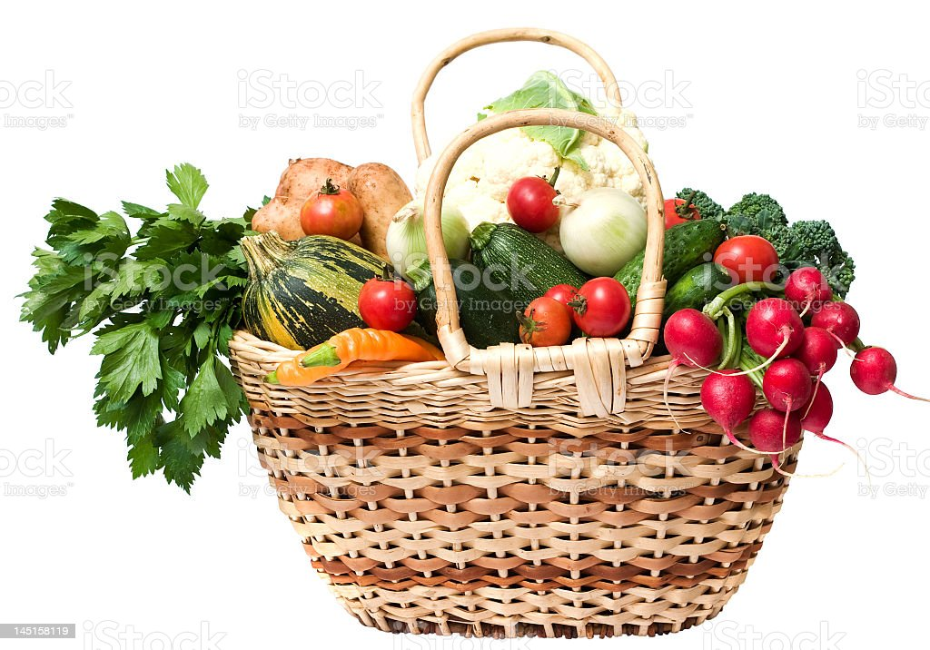 Basket full of fresh vegetables and fruits royalty-free stock photo