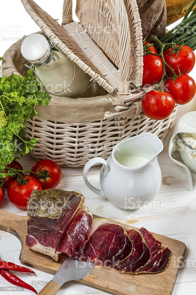 Basket full of fresh vegetables and ham royalty-free stock photo