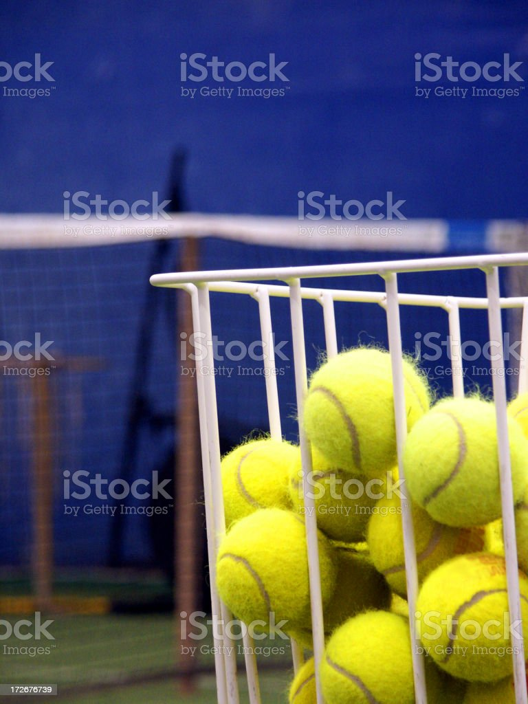 basket full of tennis balls royalty-free stock photo