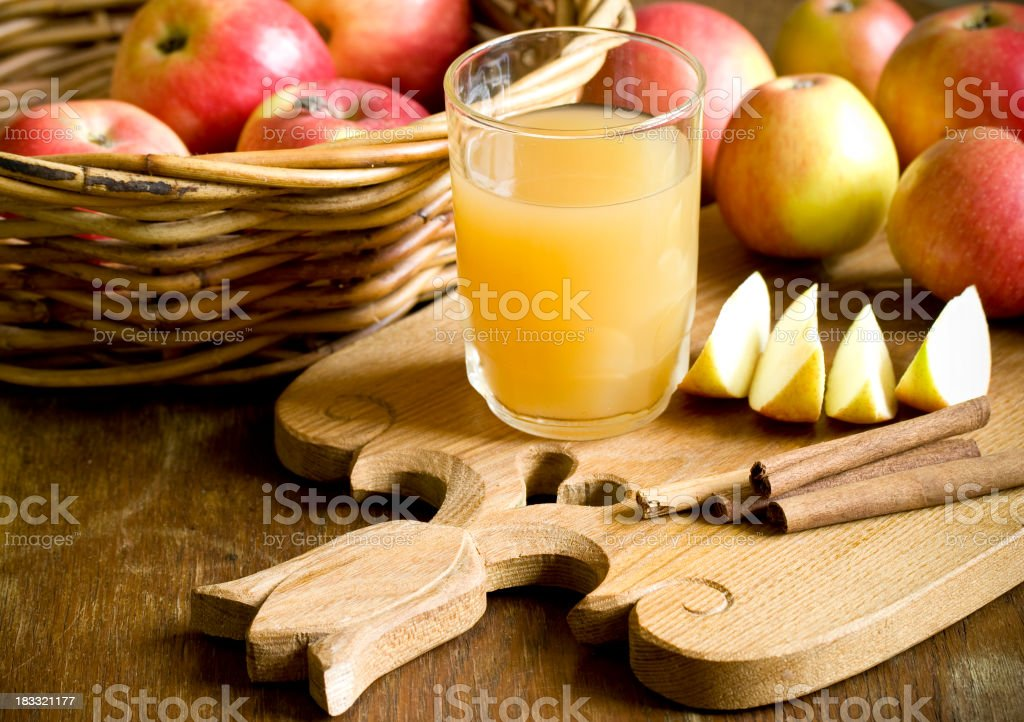 A basket of apples and apple juice stock photo