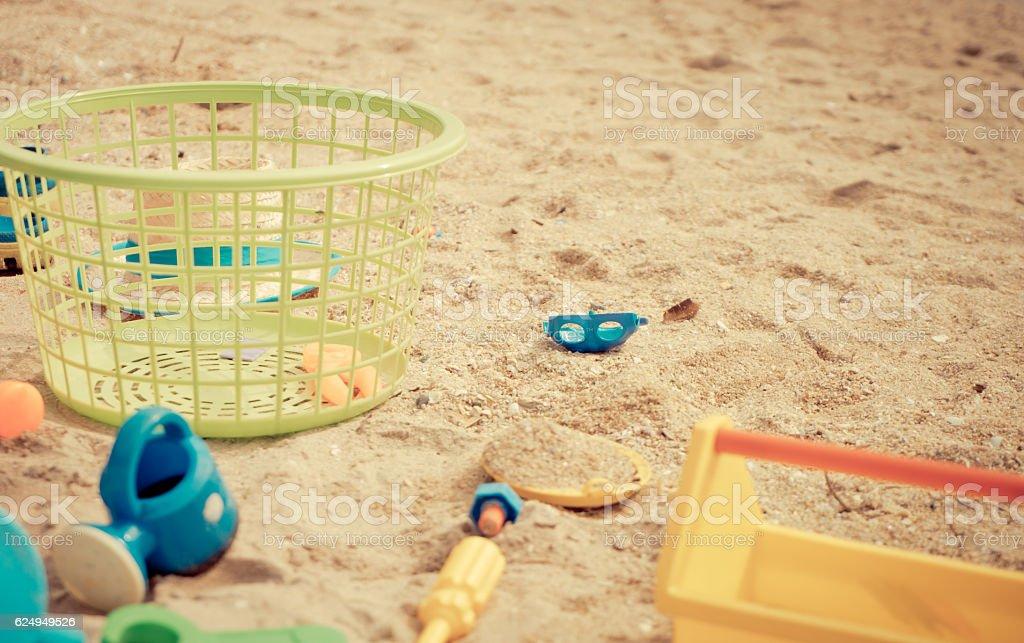 Basket of Children sandbox toy on a beach. stock photo