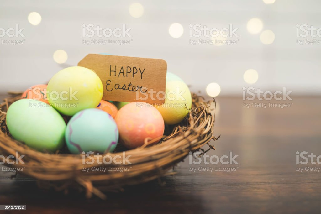 Basket of colored Easter eggs stock photo