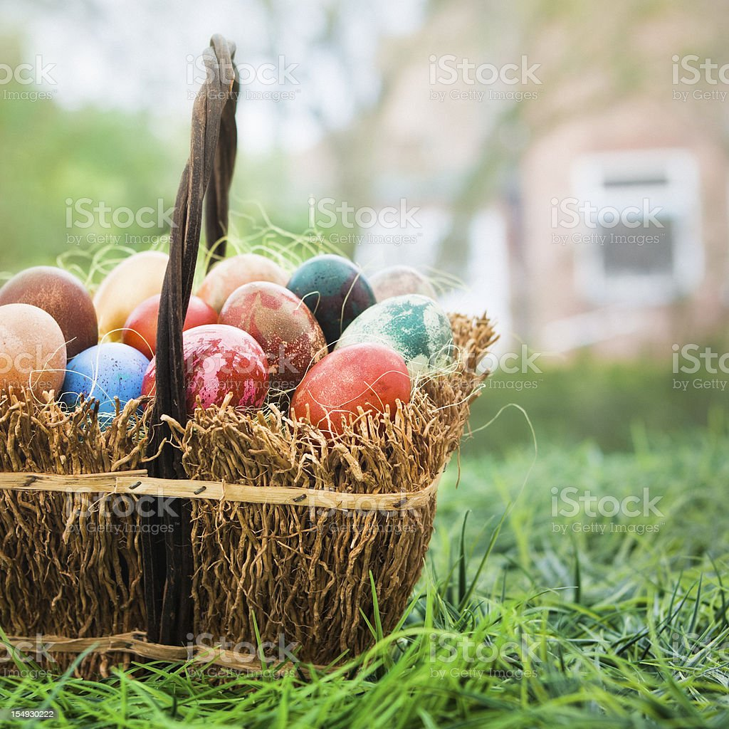 Basket of colorful Easter eggs royalty-free stock photo